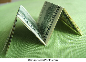 M for Money - Folded Dollar bills in M shape on a green flat...