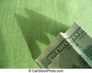 Financial Outlook - Dollar bills folded in the shape of an M...