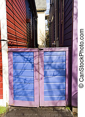 Lavender and Blue Gate - Photo of a lavender and blue wooden...