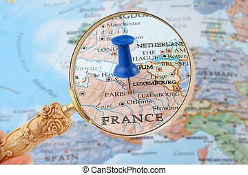 Paris map tack - magnifying glass over Paris, France map...