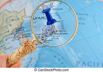 Tokyo map tack - magnifying glass over Tokyo, Japan map with...