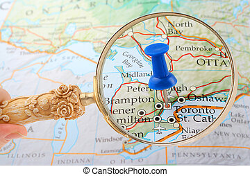 toronto map tack - magnifying glass over Toronto, Canada map...