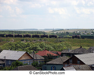 Freight - Oil railroad tanks slow move near village
