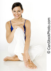Smiling Fitness - A young woman sitting on floor with great...