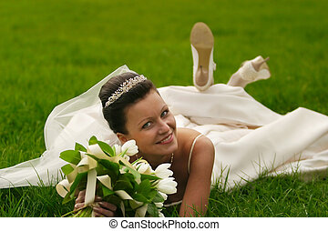 Beautiful bride - The beautiful bride with a wedding bouquet...