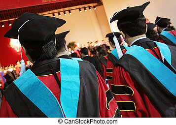 University graduates in gowns at a graduation ceremony