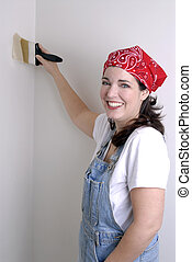Home Renovation - Young Woman Painting The Walls Of Her Home