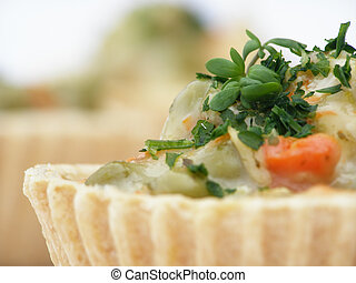 hors d\\\'oeuvre - Close-up of tartlet filled with carrot,...