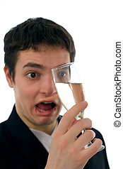 Drunk - A drunk man looking wondered and stupid to a glass...