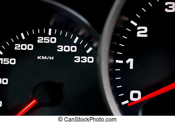 Speedometer - Sportscar dashboard closeup with backlit...