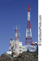 Telecoms Masts - Red and white telecommunications masts on...