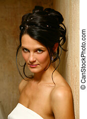 Wed Face - Bride standing against a wall looking forward