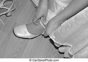 bridal shoes - bride preparing for the ceremony She is...