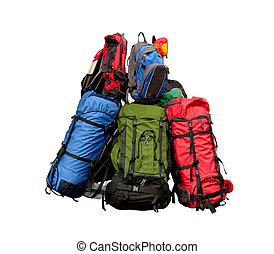 Pile of backpacks - backpacking concept isolated on white...