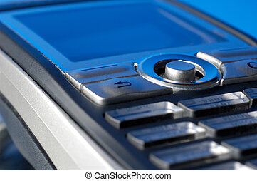 Cell Phone Closeup - Cellphone on blue macro