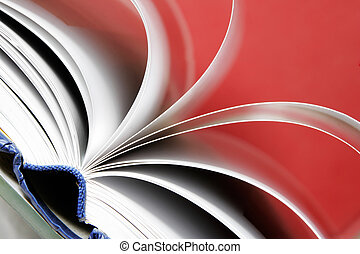 Open Book - Book with white pages open against a red...