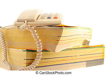 phone directories - home telephone on top of phone...