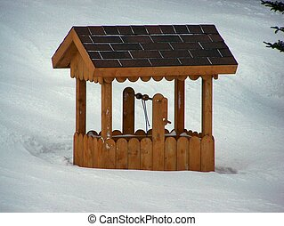 frozen wishing well - a wishing well buried in snowafter a...