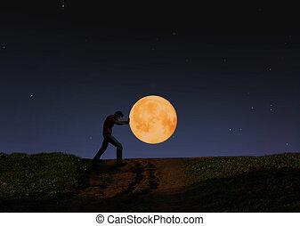 pushing the moon - photo at night