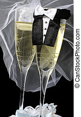 Wedding Champagne - Two champagne flutes dressed up as bride...