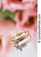 Engagement Ring - A gold engagement ring with some pink...