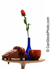 Home decorations - old retro rotary telephone and blue vase...