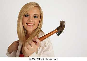 Handy Hammer - A woman holding a hammer in her hand