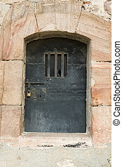Ancient metal door in Montjuic Castle, Barcelona, Catalonia,...