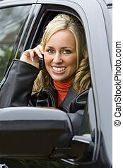 Mobile Phonecall - A beautiful young woman sitting in her...