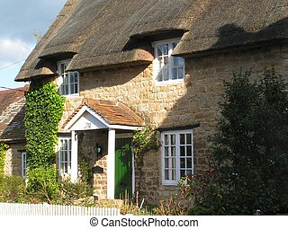 Thatched cottage - An English thatched cottage with a picket...