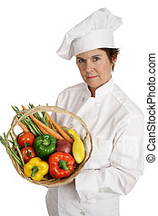 Chef - Nutrition - A female chef holding a basket of...