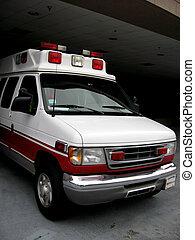 Ambulance emerging - An ambulance is emerging from a covered...