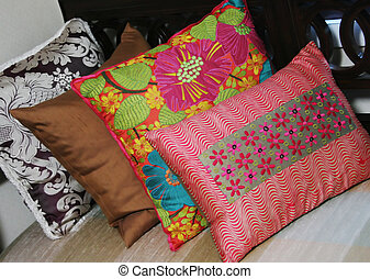 Colorful cushions - Brightly colored pillows on a sofa -...