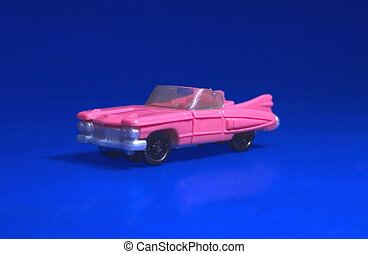 Toy Cadillac - Pink toy cadillac isolated on blue background
