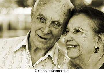 seniors in love - focus point on left woman eye,special...