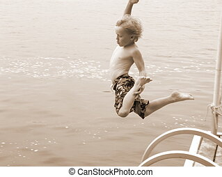 The Leap - Boy leaping off of dock at the cottage in Ontario
