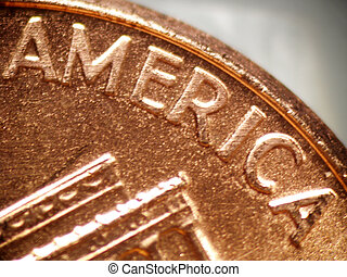 America - Macro of a penny focused on the word AMERICA...