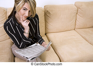 woman reading newspaper - beautiful woman sitting on the...