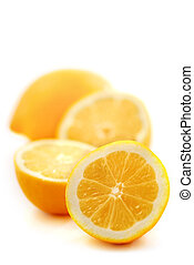Lemons - Several lemon halves isolated on white background