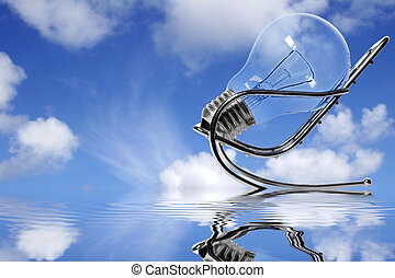 Blue Sky Thinking - Lightbulb in chair with blue sky and...
