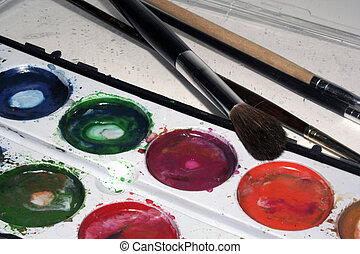 Art Tools - Paint brushes with well used multicolored...