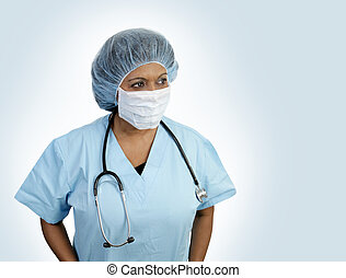 Surgical Blues - A doctor in surgical scrubs with hairnet...