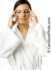 Pressing Head - A young woman in a white robe pressing her...