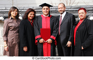 Happy family portrait - Happy university graduate with his...