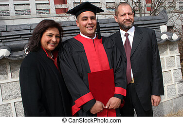 Graduation day - Happy graduate with his mother and father