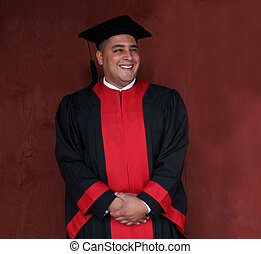 Happy graduate - Attractive man in gowns to on university...
