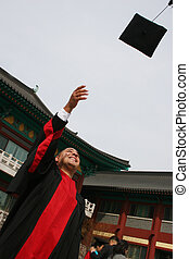 University graduate celebrates his success - Happy and...