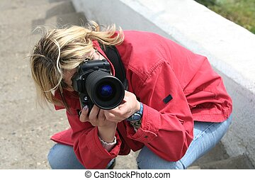 Photographer - The photographer-woman with camera at work