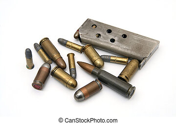 ammunition: several types of bullets and one magazine on...