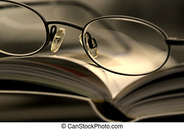 Close up on the Glasses and the Magazine - Glasses and the...